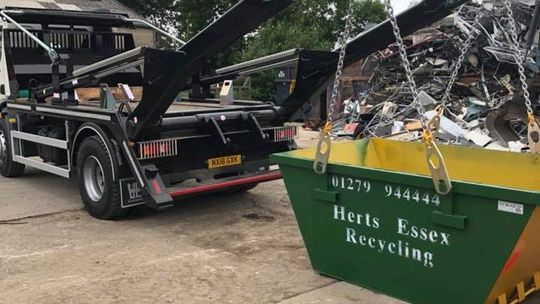 A skip being collected after being emptied
